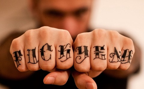 "Fabio Soares ""Fuck Yeah"" tattoo fingers by Laura Satana"