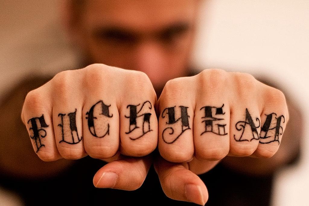 "Fabio Soares ""Fuck Yeah"" tattoo fingers by Laura Satana"