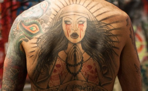 Fabio Soares back tattoo by Laura Satana